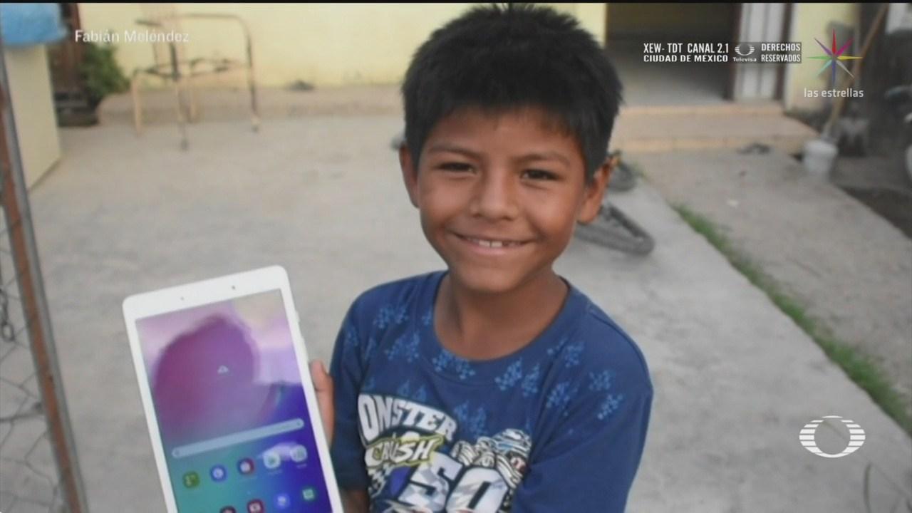 iker-nino-que-hace-mandados-por-5-pesos-recibe-tableta-para-sus-clases-en-linea-2454288